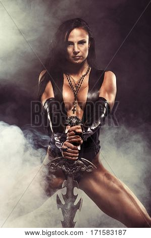Sexy Fantasy Warrior Woman with big sword on black with smoke