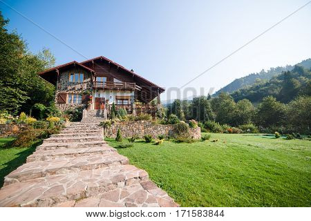 Beautiful house in high mountains during the summer.