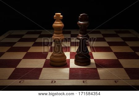 Wooden chess. Black and White King on chess board.