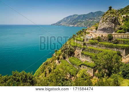 Panoramic picture-postcard view of famous Amalfi Coast with vineyards and Gulf of Salerno on a sunny day with blue sky in summer Campania Italy
