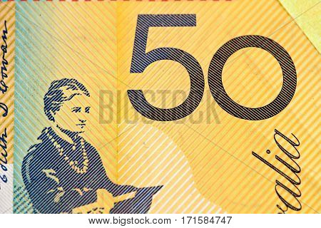 Australian 50 Dollar Bill Fragment Closeup Showing The Number Fifty On Yellow Background.