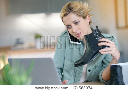 Woman on the phone with customer service department