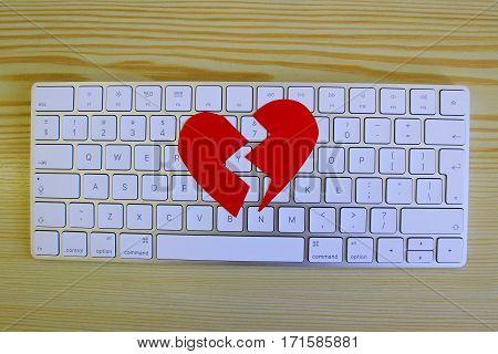 Broken heart at keybord, Valentine's Day at office