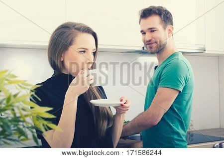 Young Couple Spends Time Together In The Kitchen