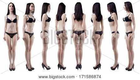 Turning around slim woman in black lingerie on white background