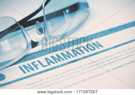 Inflammation - Printed Diagnosis on Blue Background and Eyeglasses Lying on It. Medical Concept. Blurred Image. 3D Rendering.