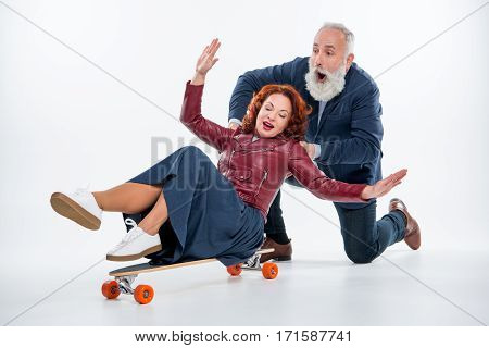 Mature Couple With Skateboard