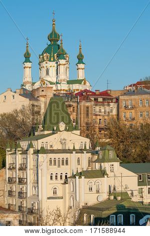 Famous St Andrew church and descent with artistic fare in Podol, historic district of Kiev