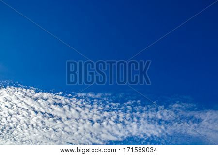 Texture of blue sky and beautiful clouds. Heavenly background on high top designs. Free space atmospheric flight and freedom.