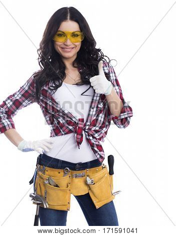 Project Satisfaction. Sexy brunette woman mechanic with yellow safety glasses, isolated over white background