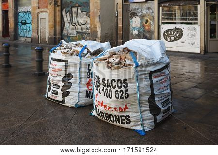 Barcelona Spain - January 08 2017: Carefully collected construction waste in bags in a street of Gothic Quarter