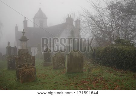 Spooky graveyard and old hospital building in Stirling.