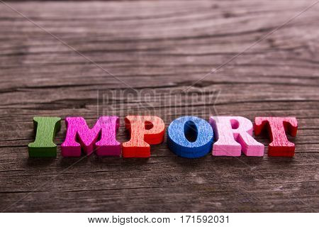 import word made from colored wooden letters on an old table. Concept