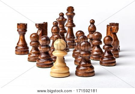 Chess. White pawn and Black figures on white background. Set of black figures. Background for presentation.
