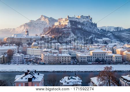 Classic view of the historic city of Salzburg with famous Hohensalzburg Fortress and Salzach river in scenic morning light at sunrise on a beautiful cold sunny day in winter Salzburger Land Austria