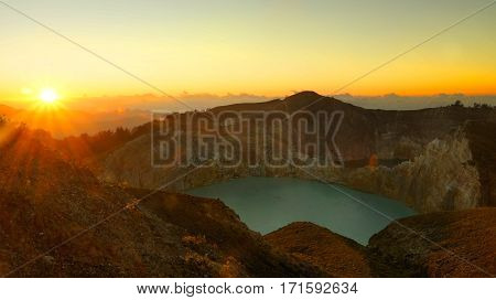 Lake in the Kelimutu volcano in Indonesia in the morning at sunrise.