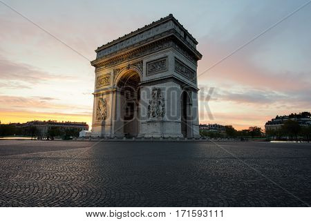 Arc de Triomphe and Champs Elysees Landmarks in center of Paris at sunset. Paris France