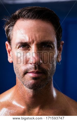 Close-up portrait of male athlete in gym