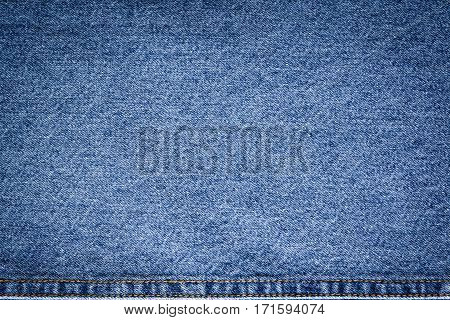 Blue Jeans Cloth With Upper Seam Background Texture Vignette.