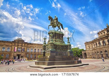 DRESDEN GERMANY - JUNE 7 2012: Monument to King Johann of Saxony in front of the Semper Opera and Dresden Art Gallery on Theater Square