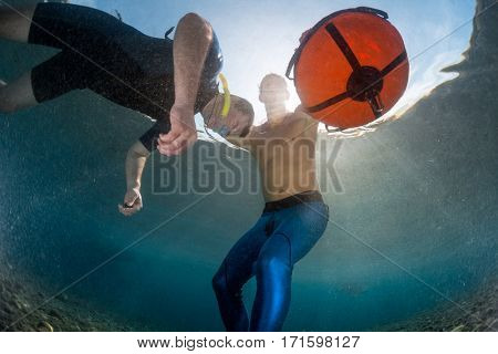 Underwater shot of free divers training in the tropical sea, Amed, Indonesia