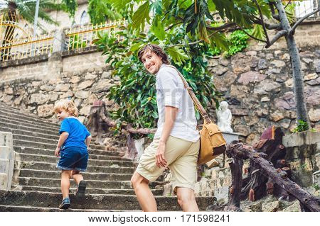 Father And Son In The Beautiful Stone Catholic Cathedral. Nha Trang Cathedral In Nha Trang, Vietnam