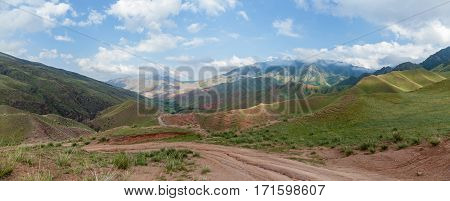 Steppe Kazakhstan Trans-Ili Alatau plateau Assy a road is in mountains