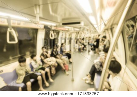 Abstract blur vintage style Passengers in a crowded Mass Rapid Transit (MRT) subway train