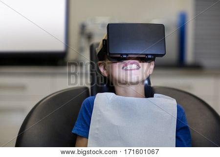 Boy using virtual reality headset during a dental visit in clinic