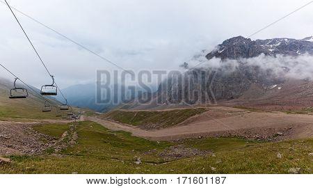 Kazakhstan mountains. Cloudy mountains of Medeu in Kazakhstan, Shymbulak.