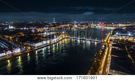 Night St. Petersburg and Neva River, Russia in aerial view