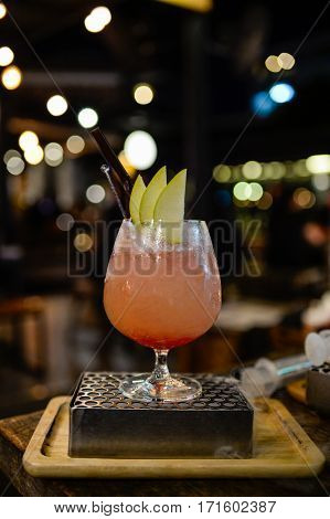 a glass of cocktail at bar and blur background