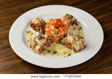 Roasted Rabbit Roulade with Carrot and tomato.