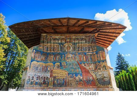 Voronet Monastery Bucovina Romania.The Last Judgment painted on the exterior of the church.