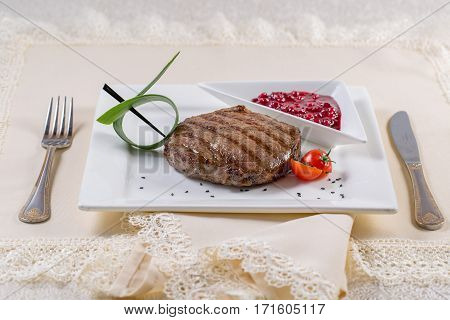 Assorted delicious grilled meat with vegetable over the coals on a barbecue. Grilled meat with rosemary on wooden board. Grilled meat with rosemary on wooden board