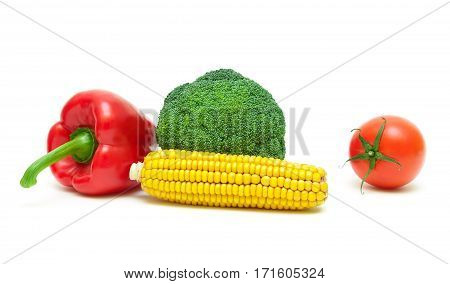 broccoli tomatoes corn and sweet pepper on a white background. horizontal photo.