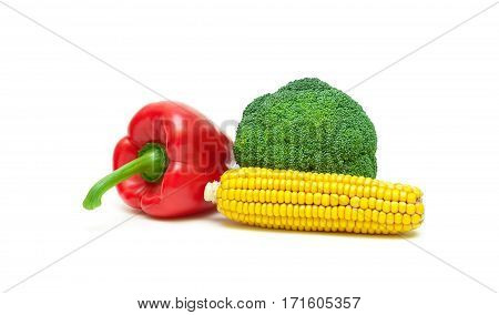 corn on the cob broccoli and sweet peppers isolated on white background. horizontal photo.