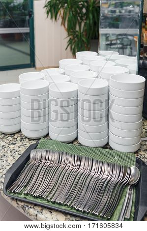 Stack of soup bowls prepared for visitors of the restaurant
