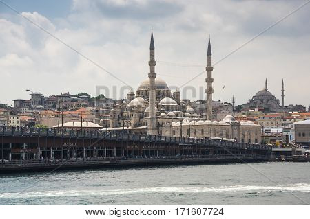 ISTANBUL TURKEY - JUNE 25 2015: View on New Mosque and Suleymaniye Mosque in Eminonu Istanbul Turkey