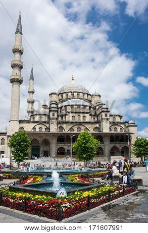 ISTANBUL TURKEY - JUNE 25 2015: The Yeni Cami ( New Mosque) is an Ottoman imperial mosque located in the Eminonu quarter of Istanbul Turkey