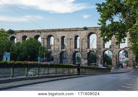 ISTANBUL TURKEY - JUNE 25 2015: The Valens Aqueduct is a Roman aqueduct which was the major water-providing system of Constantinopole modern Istanbul Turkey