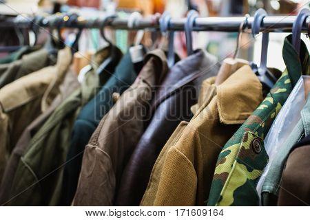 Old retro military uniform hanging in the closet. Men's stylish jacket.