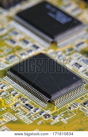 Electronic chip and standard inscriptions of resistors and condensers small depth of sharpness