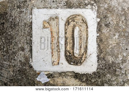 The Digits With Concrete On The Sidewalk 10