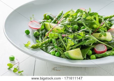 Fresh Green Salad With Spinach, Radishes And Asparagus