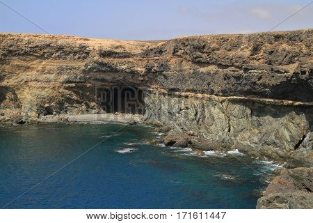 Black Volcanic Caves On The Coast Near Ajuy Village, Fuerteventura