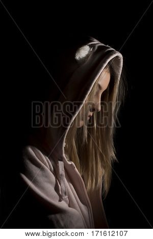 Blond woman wearing pink cardigan with hood