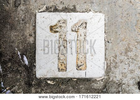 The Digits With Concrete On The Sidewalk 11