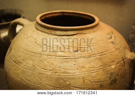 Clay ancient jug with a pattern. Old dishes. A vessel for water.