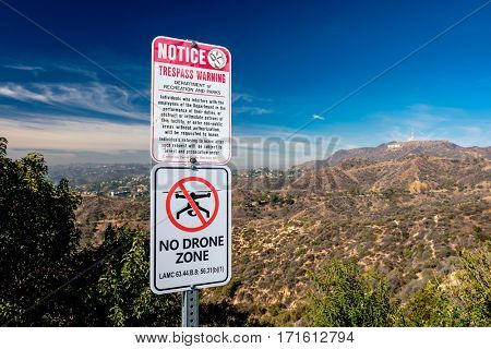 LOS ANGELES, CA - NOVEMBER 07: No drone zone sign at Griffith Park with view at Hollywood, in Los Angeles, California, USA.